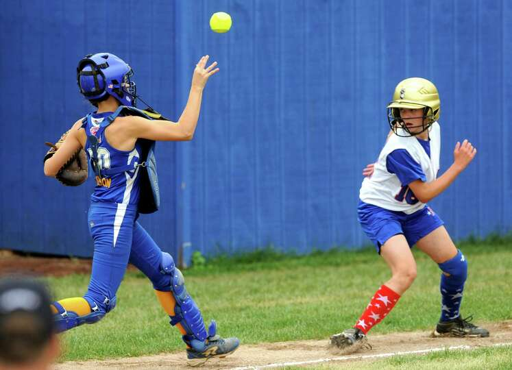 Seymour's Rebecca Johnson chases down Mid Island runner Kailey Wonica between third base and home pl