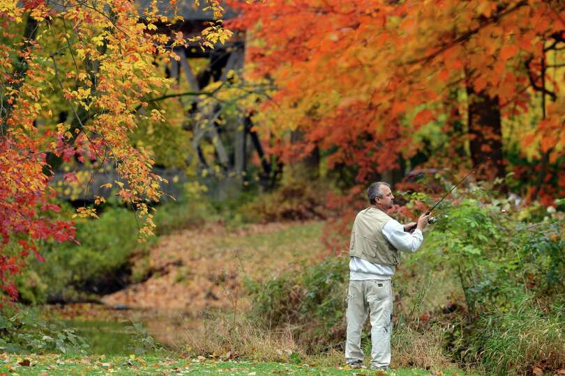 Paul Hurteau, of Trumbull, fishes for trout in the Pequonnock River after the weather cleared up on