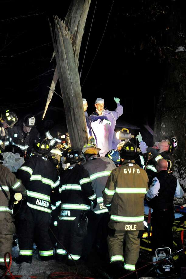 Four people were trapped in an extended cab pickup truck Monday Jan. 28, 2013 following an accident on Clapboard Ridge Road in Danbury, Conn. The accident happened before 5:30 p.m. near the intersection with Old Hay Rake Road. Two women and two men were involved in the accident.Surgeons were called to the scene. Photo: Michael Duffy / The News-Times