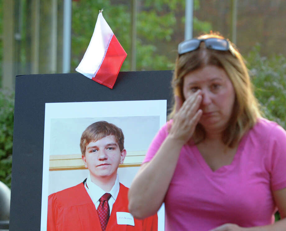 Lori Keegan of Norwalk wipes away a tear during the Vigil Prayer Service for Bart Palosz at Greenwich High School, Tuesday night, Sept. 10, 2013. Palosz committed suicide after attending the first day of classes as a sophomore at Greenwich High school. The Palosz family says the suicide is the result of school bullying over a period of years. Photo: Bob Luckey / Greenwich Time