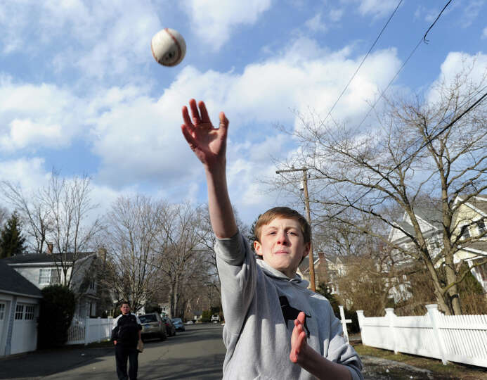 James Walsh pitches during a pick-up game of baseball at Grove Street in Cos Cob on the first day of