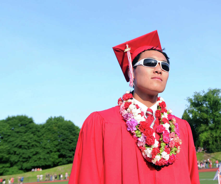 Graduating senior, James Yoon, 18, during the Greenwich High School graduation ceremony at Cardinal Stadium, Friday evening, June 21, 2013. Yoon said he will be attending Ithaca College in the fall. Photo: Bob Luckey / Greenwich Time