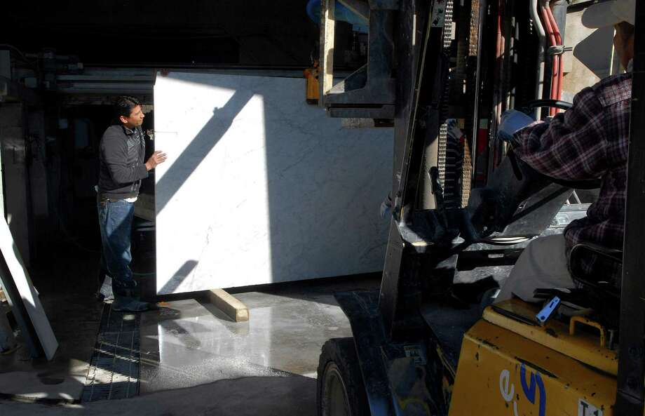 A slab of marble is fork lifted into a room for cutting at Paramount Stone Company in Stamford, Conn. on Monday November 18, 2013. Photo: Dru Nadler / Stamford Advocate Freelance
