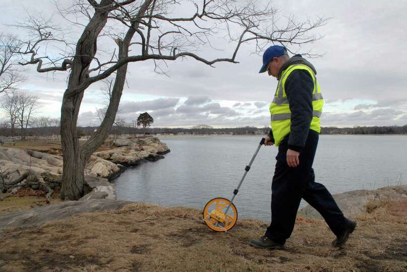 Jeff Pardo from the City of Stamford engineering department measures at Cove Island Park in Stamford
