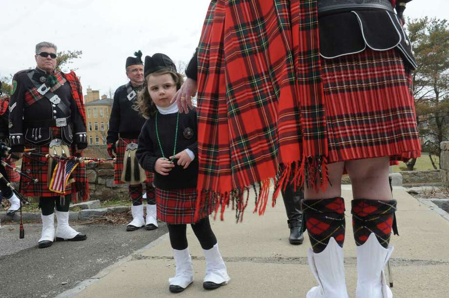 Madeline MacLennan, 4, with her grandfather, Don MacLennan, of Westchester Firefighters Emerald Society, gets ready for the Greenwichís 39th annual St. Patrickís Day parade at Greenwich Avenue, in Greenwich, Conn., March 17, 2013. Photo: Helen Neafsey / Greenwich Time