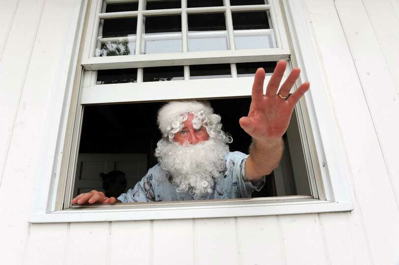 K.O. O'Conner plays Santa Claus for Christmas at Island Beach, in Greenwich, Conn., Sunday, Sept.1,
