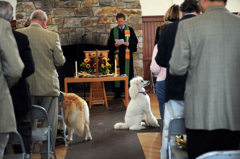 The Rev. Dr. Edward G. Horstmann prays at Round Hill Community annual Blessing of the Animals, in Gr