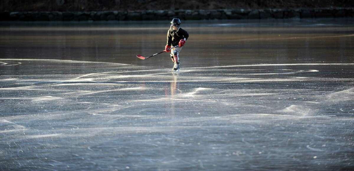 Jimmy Kuehler, 8, skates on frozen Gorhams Pond in Darien on Thursday, January 24, 2013.
