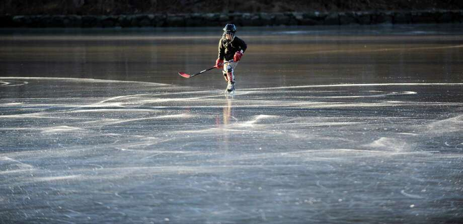 Jimmy Kuehler, 8, skates on frozen Gorhams Pond in Darien on Thursday, January 24, 2013. Photo: Lindsay Perry / Stamford Advocate