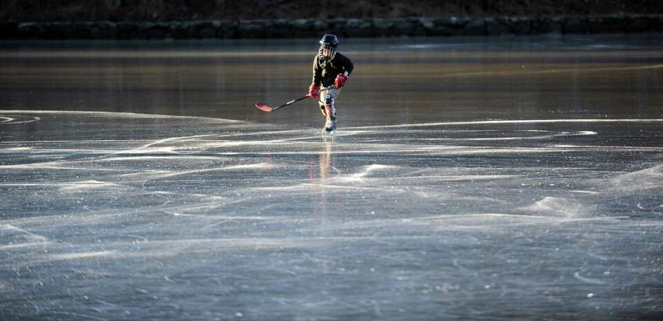 Jimmy Kuehler, 8, skates on frozen Gorhams Pond in Darien on Thursday, January 24, 2013.