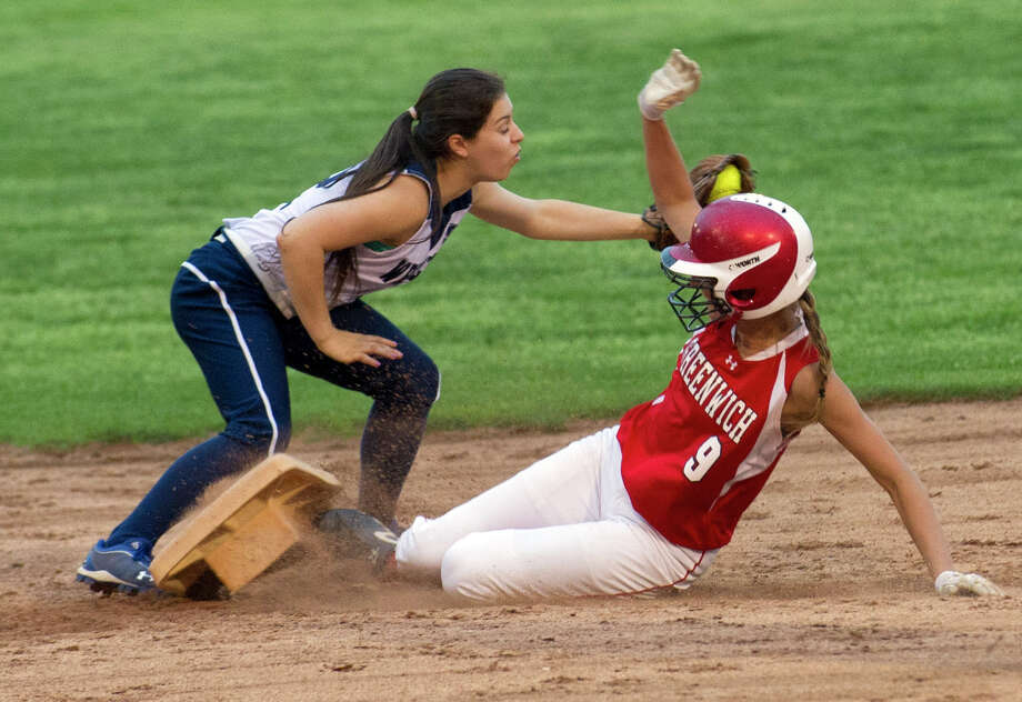 Greenwich's Madison Burhans is safe at second base as Staples' Gabby Perry reaches to tag during Friday's softball game at Greens Farms Elementary School in Westport, Conn., on May 10, 2013. Photo: Lindsay Perry / Stamford Advocate