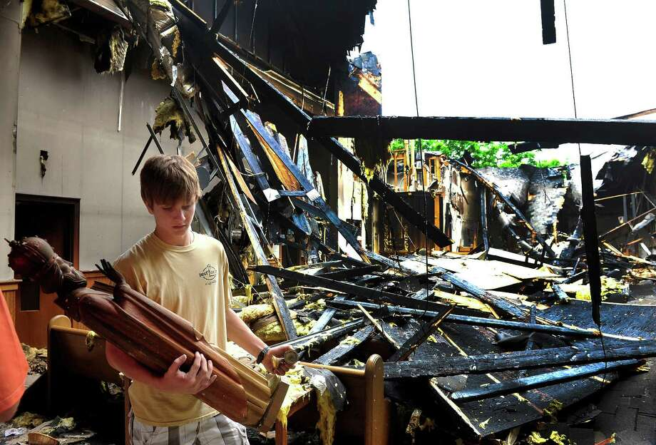 Nick Russo, 16, saves religious relics after Saturday's fire at St. Nicholas Byzantine Church in Danbury, Conn. Sunday, June 30, 2013. Photo: Michael Duffy / The News-Times