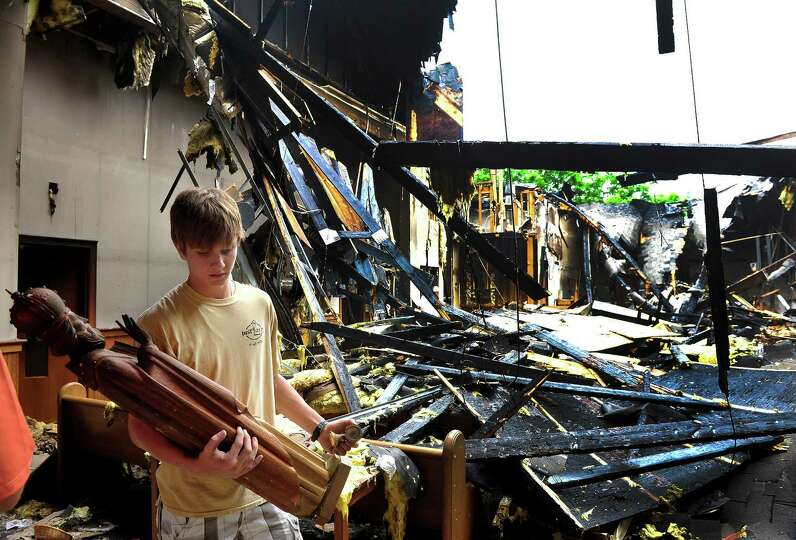 Nick Russo, 16, saves religious relics after Saturday's fire at St. Nicholas Byzantine Church in Dan