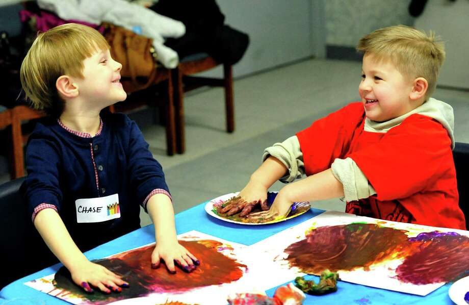Chase Amalfitano, left, and Chase Sylvia, both 4, delight in the mess of finger paint during the Start With Art program at the Brookfield Library Thursday, Jen. 24, 2013. Photo: Michael Duffy / The News-Times