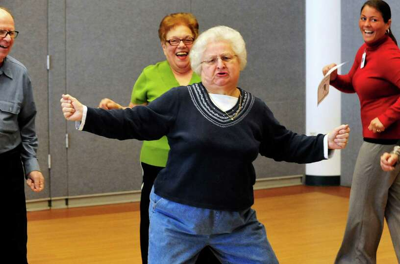 Eleanor Elias, 75, gets her groove on during Freestyle Dance at Elmwood Hall in Danbury, Conn. Monda