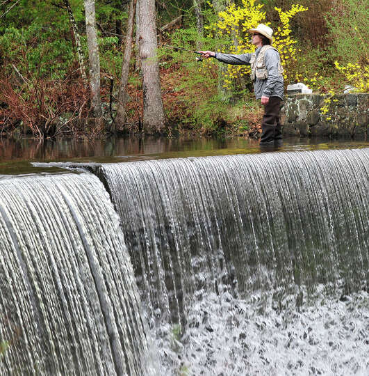 Chett Kensek, of New Milford, casts his line early on the opening day of fishing season along the Sa