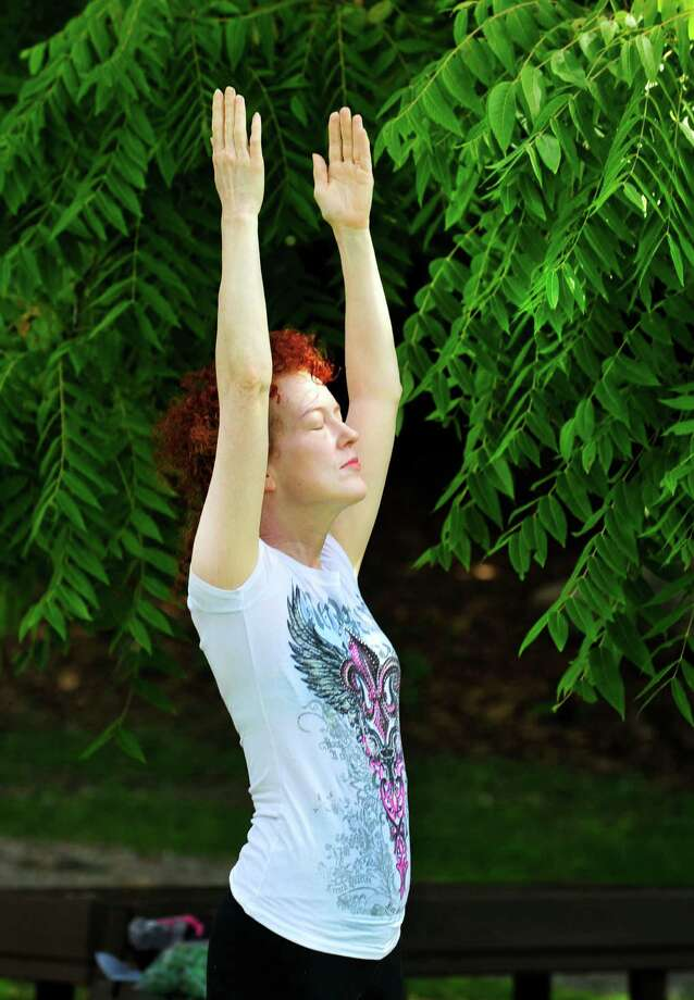 Sheila Bonnabeau practices her upward salute during Yoga at Tarrywile, in Danbury, Conn. Sunday, Aug. 4, 2013. Photo: Michael Duffy / The News-Times