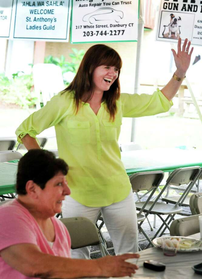 "Rima Pisciotto does a Mideastern dance at St. Anthony Maronite Church Lebanese Heritage Festival ""Mahrajan,""  in Danbury, Conn. Friday, Aug. 16, 2013."" Photo: Michael Duffy / The News-Times"