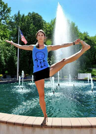 Stephanie Romano holds a tree pose during the Newtown Yoga Festival sponsored by Sandy Hook Promise,