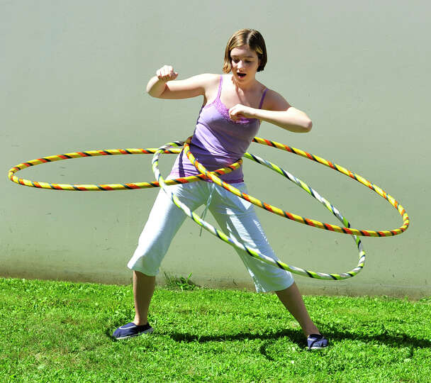 Hannah Mata, 13, attempts to hula multiple hoops at the Newtown Yoga Festival sponsored by Sandy Hoo