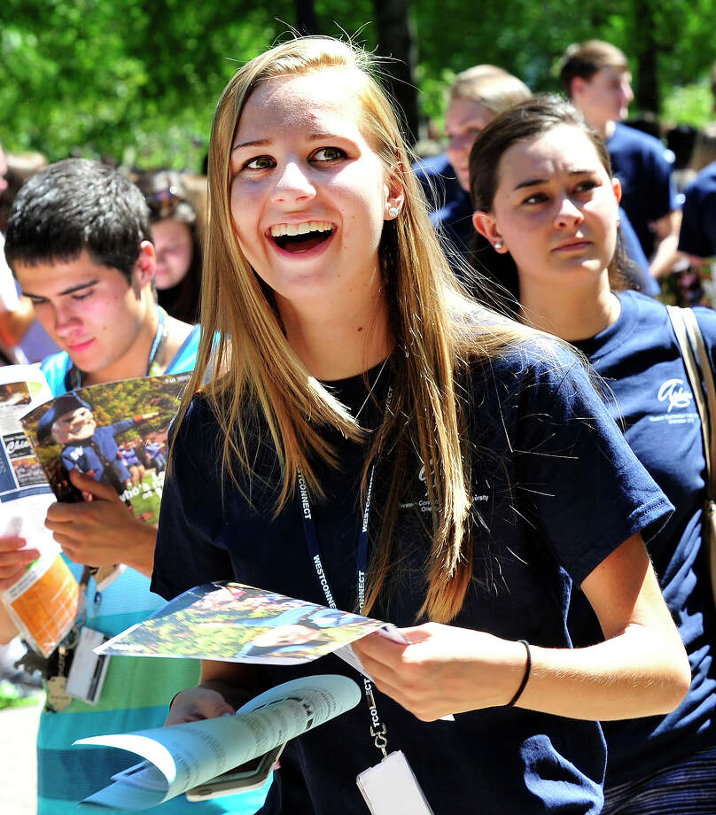 "Stephanie Plvmeau passes through the gates with the class of 2017, as Western Connecticut State University holds its traditional ""Entering the Gates"" ceremony at the university's Midtown campus in Danbury, Conn. Sunday, Aug. 25, 2013. Photo: Michael Duffy / The News-Times"
