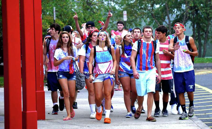 Senior class members leave the school stadium after a rally to begin the first day of classes at New
