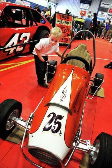 Jackson Betts, 3, checks out a midget racer during the Southern New York Racing Association holds it