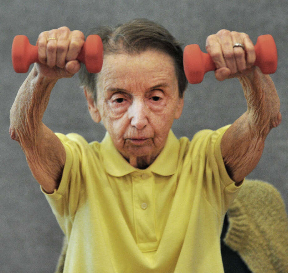 Mary Williams, 92, concentrates on lifting hand weights during Strength Training in the Miry Brook room at Elmwood Hall, the Danbury, Conn., Senior Center, Monday, Sept. 23, 2013. Photo: Michael Duffy / The News-Times