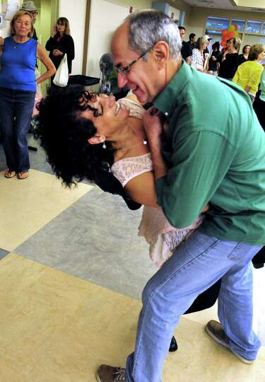 Alan Walp dips his wife, Nili, as they dance during Brookfield Day in Brookfield, Conn. Sunday, Oct.