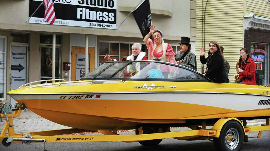 A speedboat races down Greenwood Avenue carrying Rich Zuvich as Christopher Columbus, left, and Gina Clarizio as Queen Isabella, during the 31st annual Columbus Day observance in Bethel, Conn. Monday, Oct. 14, 2013. Photo: Michael Duffy / The News-Times