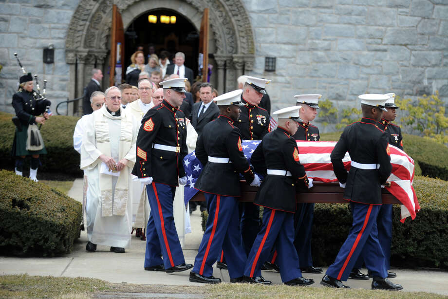 Marines carry the casket of Lance Cpl. Roger ìR.J.î Muchnick from St. Annís Church, in Lenox, Mass., following his funeral service March 29, 2013. Muchnick was one of seven Marines killed by an explosion during a training exercise in Nevada on March 18th. He attended Staples High School, in Westport, Conn. in 2008. Photo: Ned Gerard / Connecticut Post