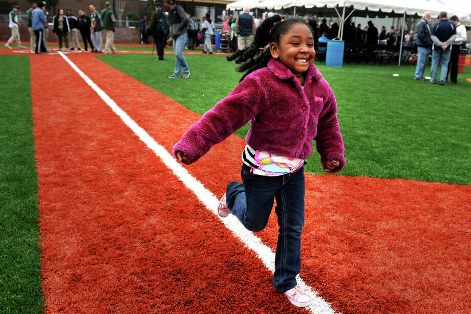 Skye Mercado, 5, of Bridgeport, runs down the first base path on the baseball field following the dedication of NAPA Auto Parts Park, in Bridgeport, Conn., Aptil 18th, 2013. The park was built with the help of baseball hall of famer Cal Ripken Jr., and the Cal Ripkin, Sr. Foundation. Photo: Ned Gerard / Connecticut Post