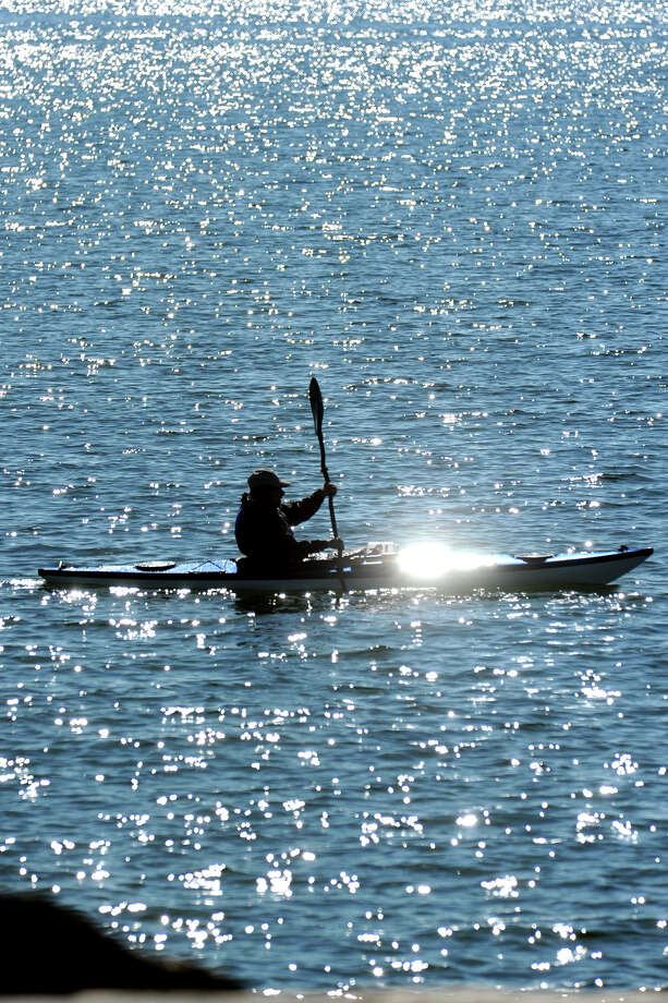 A kayaker paddles on Long Island Sound near Seaside Park, in Bridgeport, Conn., Oct. 15, 2013. Photo: Ned Gerard / Connecticut Post