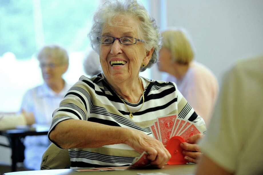 "Elizabeth Nelson, 89, was dubbed ""Lucky Liz"" by a fellow bridge player Tuesday, August 6, 2013, at the Brookfield Senior Center in Brookfield, Conn.  Seniors meet twice a week at the senior center to play cards. Tuesday its bridge and pinochle. Thursdays its bridge and poker as well as mahjong. Photo: Carol Kaliff / The News-Times"