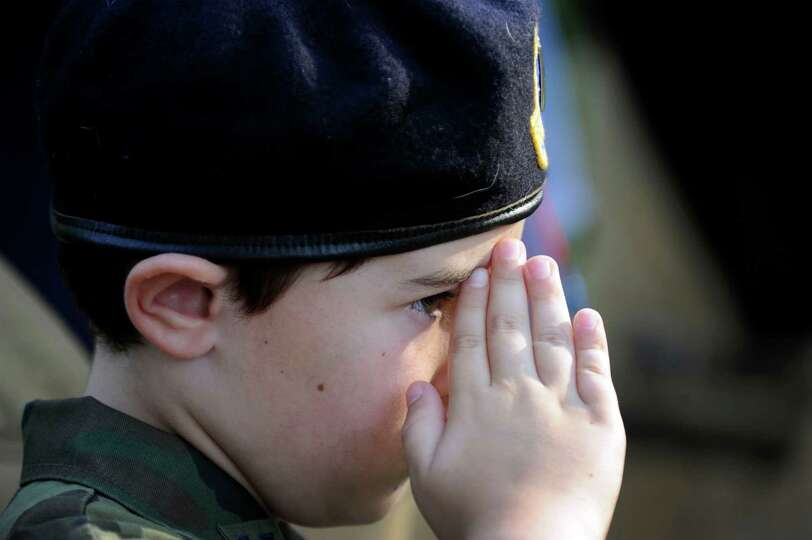 Steven Johnston, 9, of New Fairfield, salutes during an annual memorial service to honor the victims