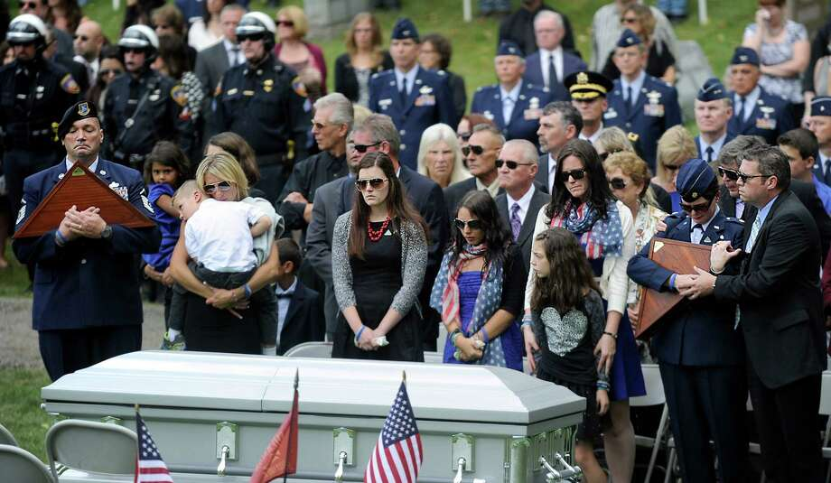The family of Staff Sgt. Todd T.J. Lobraico Jr. stands by his coffin at a graveside ceremony at North Cemetery in Sherman, Conn., Friday, Sept. 13, 2013. Photo: Carol Kaliff / The News-Times