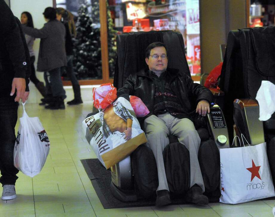 Jeff Sievering, 52, visiting family in the area for Thanksgiving, did some after dinner shopping at the Danbury Fair Mall late Thursday night. By midnight he was ready for the massage chair. Thursday, Nov. 28, 2013. Photo: Carol Kaliff / The News-Times