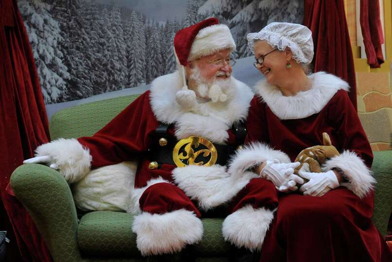 Santa and the Mrs. spend some quiet time together in between visits from children at the Danbury Fai