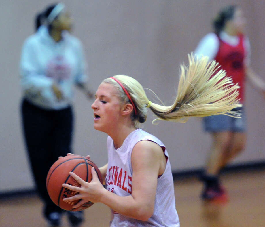 Greenwich High School basketball player Rebecca DeCarlo throws a pass during Greenwich High School girls varsity basketball practice at the school in Greenwich, Friday, Dec. 6, 2013. Photo: Bob Luckey / Greenwich Time