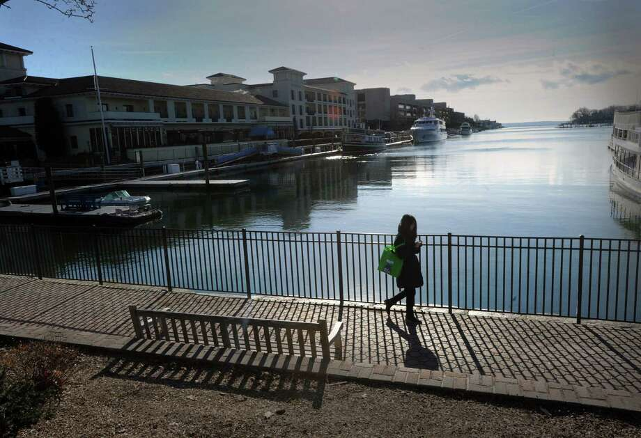 A woman enjoys an early morning stroll on the walkway at the top of Greenwich Harbor, Saturday, Nov. 30, 2013. Photo: Bob Luckey / Greenwich Time