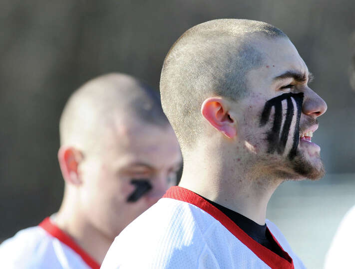 At right, Shawn Dunster of Greenwich during the boys high school lacrosse match between Greenwich Hi