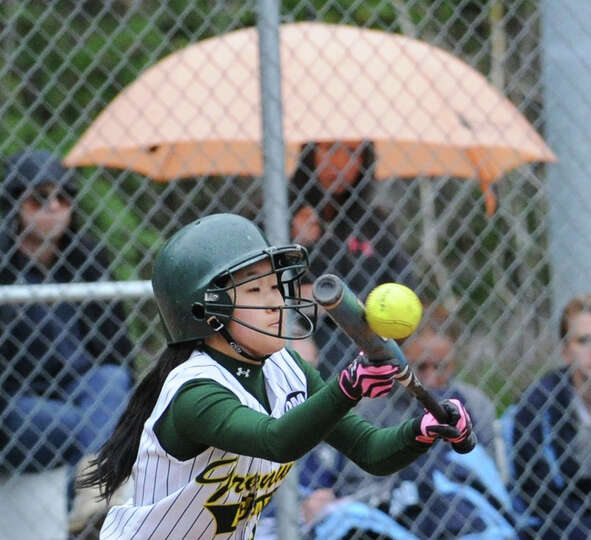 Hiromi Terai of Greenwich Academy bunts during the high school softball game between Greenwich Acade