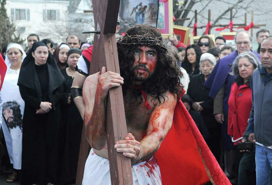 St. Benedict's/Our Lady of Montserat and St. Mary's parish join together in Stamford, Conn. on Friday March 29, 2013 to perform a live stations of the cross march from Cummings Park to St. Mary's. Amilar Oliva plays Jesus in the reenactment Photo: Dru Nadler / Stamford Advocate Freelance