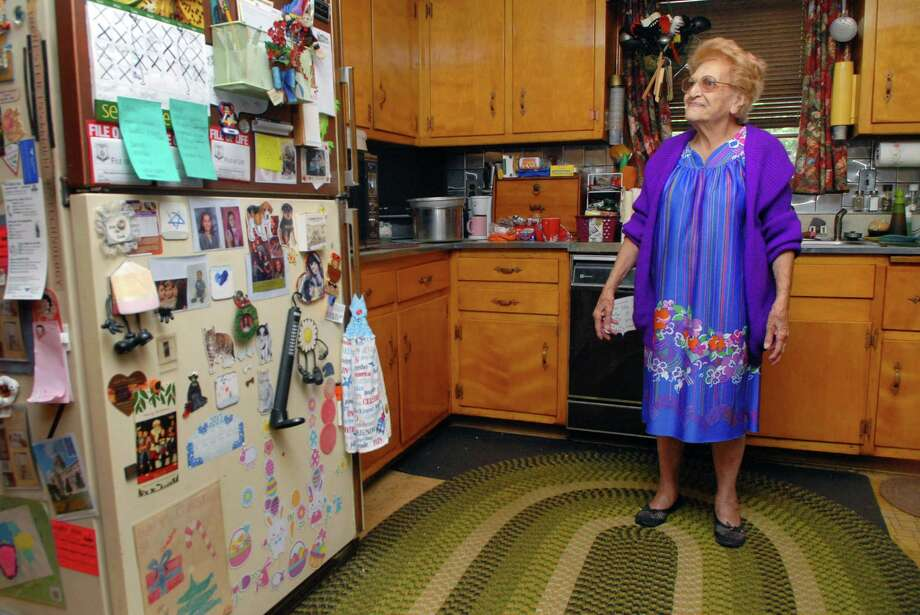 Ann Sorese, 93, lives the house her husband built on Bouton Street West in the Springdale section of Stamford, Conn. in the 1950's. She's photographed on Monday September 23, 2013 in her kitchen. Photo: Dru Nadler / Stamford Advocate Freelance