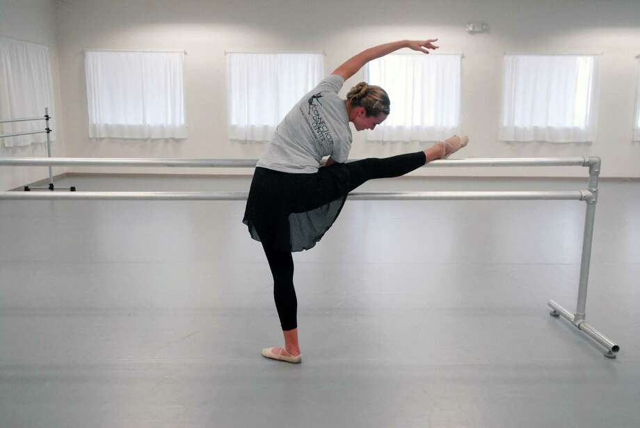 Shannon Chapman, who teaches pre ballet and tap at the Connecticut Dance Center on Viaduct Road in Stamford, Conn., practices in the studio on Monday September 16, 2013. Photo: Dru Nadler / Stamford Advocate Freelance