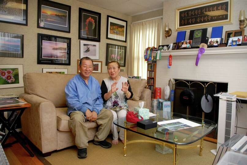 Retired surgeon Chan-Kook Rha and his wife Lori in their Bedford St home in Stamford, Conn. on Monda