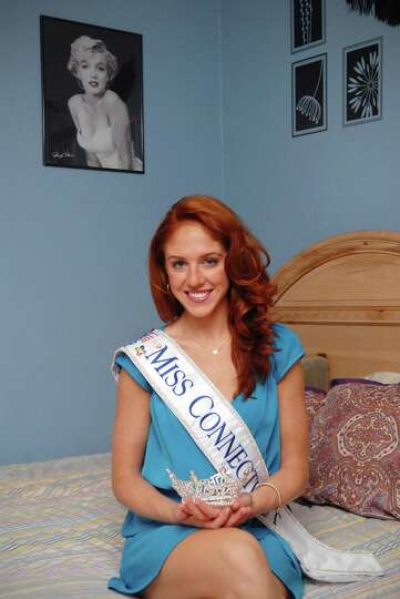 Kaitlyn Tarpey who recently was crowned Miss Connecticut poses in her Stamford, Conn. home on Friday