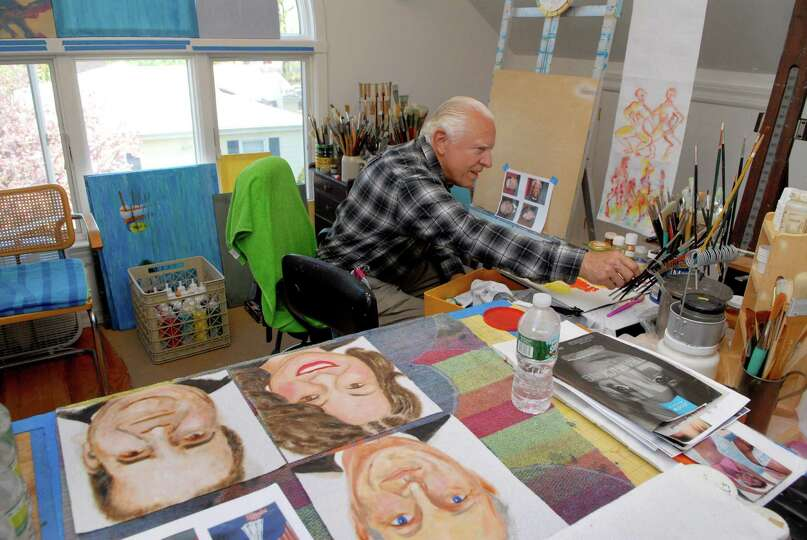 Ken Delmar works on his paintings of Supreme Court justices in his studio on Gurley Rd in Stamford,