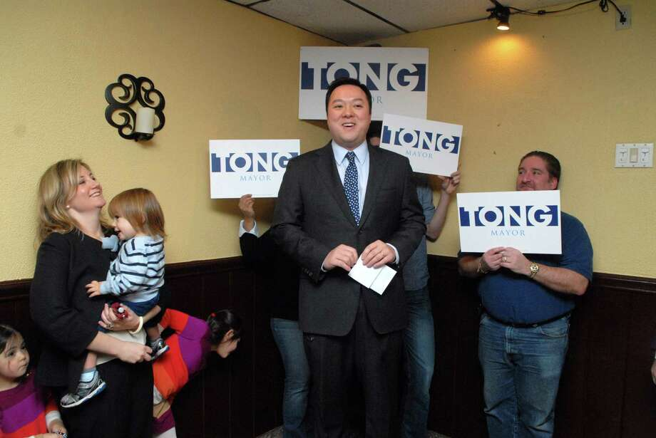 State Rep. William Tong  announces his candidacy for mayor on Monday February 4, 2013 at Sorrento Pizzeria & Restaurant on High Ridge Road in Stamford, Conn. with his wife Elizabeth and children by his side. Photo: Dru Nadler / Stamford Advocate Freelance