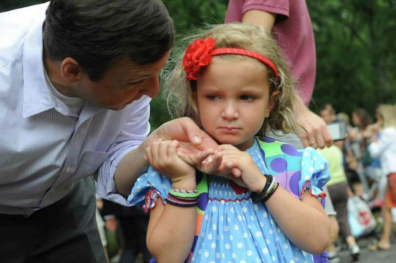 Greg Trager comfort his daugher Sadie, 4, during the